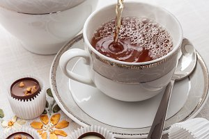 Tea and chocolate sweets.