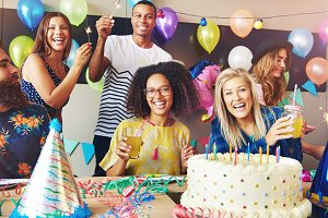 Six young adults celebrating a birthday party