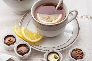 Chocolate sweets and tea with lemon