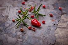 Red chilli pepper, rosemary and salt