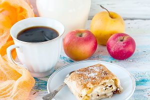 Sweet roll with apple and coffee