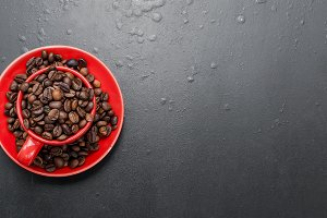 Red cup and coffee beans