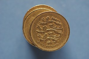 1 pound coin, United Kingdom over blue with copy space