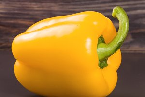 yellow sweet pepper on black background