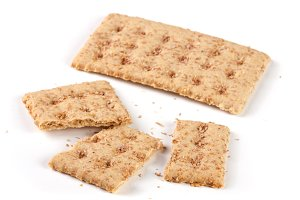 one whole and the broken grain crispbreads isolated on white background