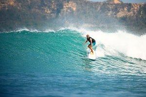 Surfer on a blue wave