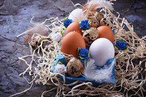 Chicken and quail eggs in carton box