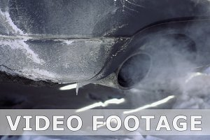 Car pipe puffs exhaust gas slow motion