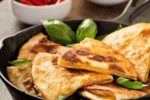 Cheese quesadillas in a cast iron pan
