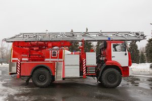 Fire truck with ladders and hoses - big red Russian fire fighting vehicle