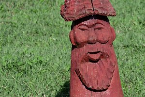 Wooden statue in the shape of a man in the park