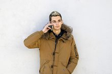 young man with the phone on the wall