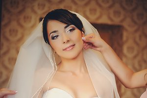 Pretty bride poses in the room