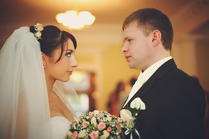 Bride and groom look at each other