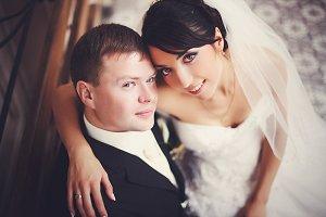 Groom and bride with hazel eyes