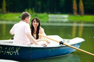 Smiling bride and groom in the boat