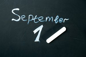 September 1 The phrase written in chalk on the blackboard.
