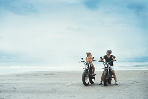 couple bikers on the beach