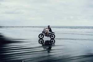 Man on a motorcycle on the ocean