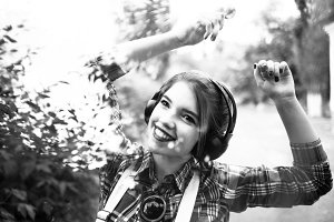 Hipster girl enjoying music