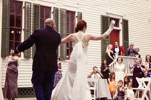 Military Lieutenant dancing newlywed