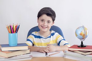 Smiling boy studying