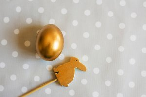 Gold easter egg and wood rabbit