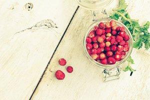 Wild strawberry in glass jar