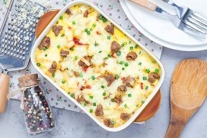 Egg casserole with potatoes, sausage and pepper, in baking dish, horizontal, top view