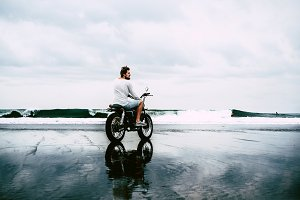 Man motorcycle ocean
