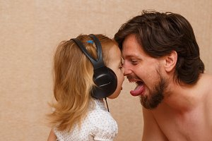Little girl and dad listens to music