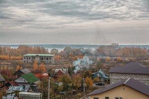 autumn landscape with smoke