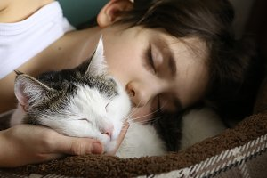 teen boy sleep with cat