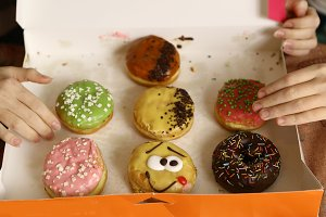 multi colored doughnuts in box