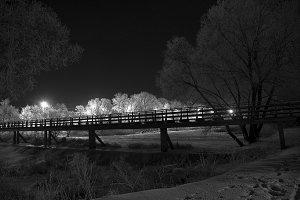 Pedestrian bridge at night.