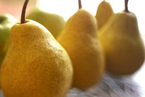 big whole yellow pears close up photo