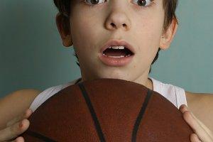 teenager boy with basketball ball