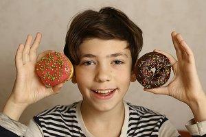 teen boy with doughnuts ears smiling