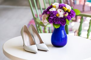 Wedding bouquet of pink and purple flowers and shoes
