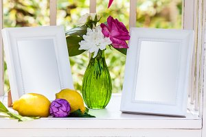 White photo frames on the table for wedding decoration