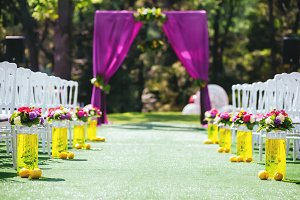 Beautiful wedding archway with chairs on on each side