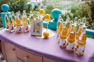 Lemonade table decorated with lemons and photo frame