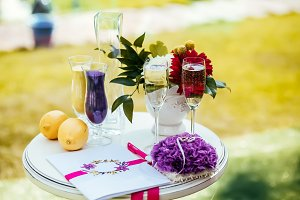 Small table with greeting album and wedding rings