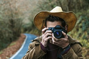 male young de style hipster with the camera's photos