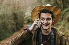 young man of style hipster with mobile phone