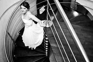 A bride walking downstairs