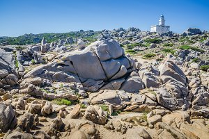 White lighthouse of Capo Testa in north Sardinia, Hudge Granite Rocks in front