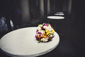 Lonely wedding bouquet on the table