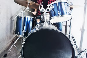 Drummer musician playing on drums.
