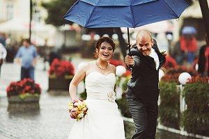 Groom runs to a bride